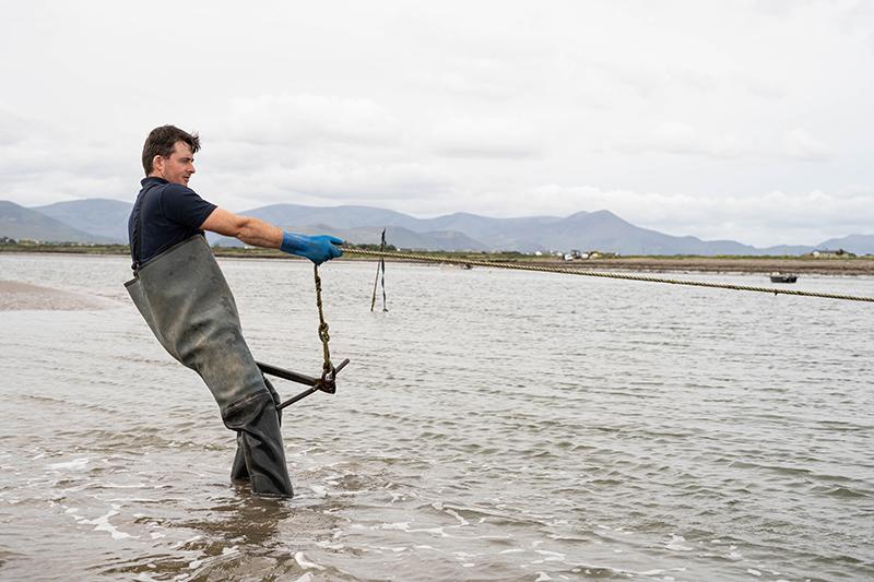 Fisherman hauling rope