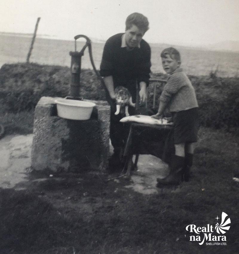 Patrick Casey as a young boy gutting a Cromane Salmon